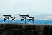 Benches on the Porporela (breakwater) at sundown, Dubrovnik old town, Croatia