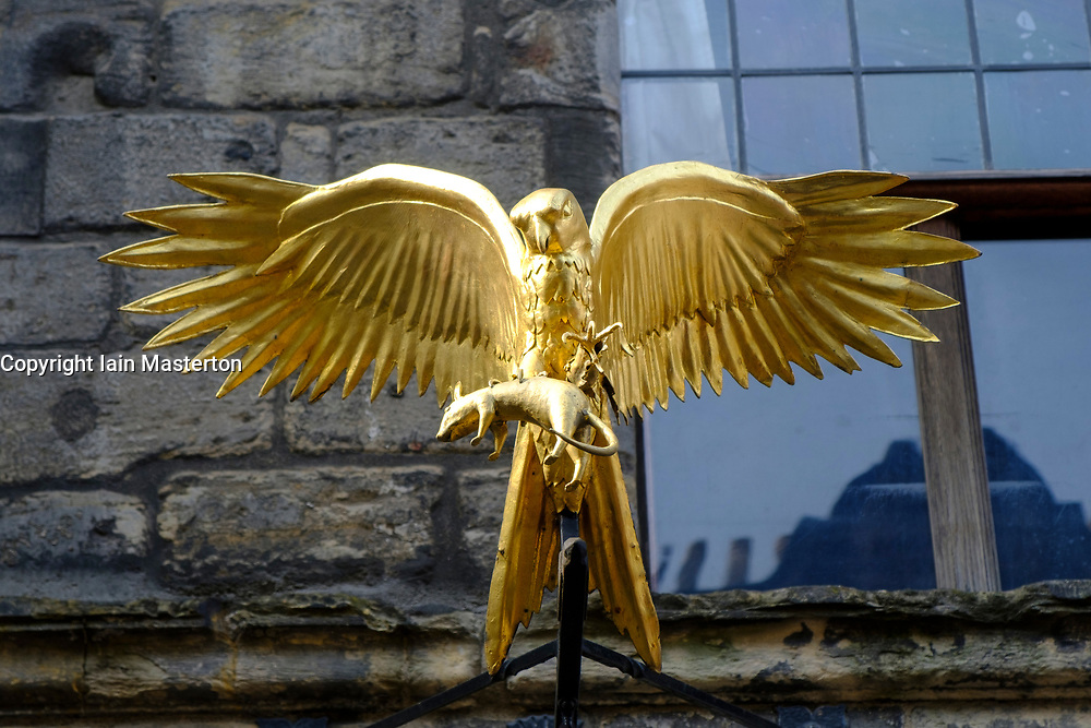 Golden bird outside Gladstone's Land original old tenement building at Lawnmarket in Edinburgh Old Town, Scotland, UK