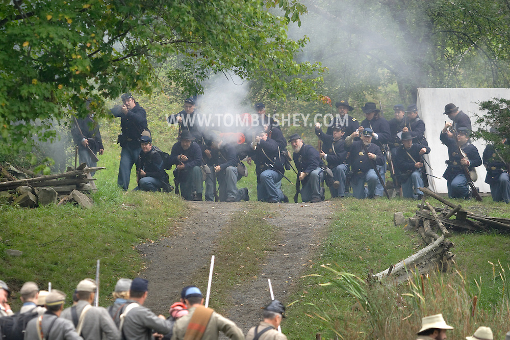 Montgomery, N.Y. - Members of the 124th New York State Volunteers fire on a Confederate position during a Civil War reenactment at the Orange County Farmers Museum on Sept. 23, 2006.