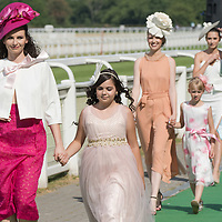 Models present various hats and dresses at a fashion show held at Hungarian horse race derby in Budapest, Hungary on July 4, 2021. ATTILA VOLGYI