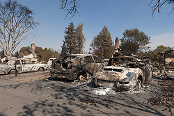 Burned out cars sit in the rubble of homes destroyed by the Tubbs Fire in Santa Rosa, California