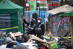 © Licensed to London News Pictures.28/01/2021, London,UK. The eviction of HS2 Rebellion group from Euston Square Gardens in central London began yesterday and continues today. It is reported the protesters have built a 100ft tunnel under the gardens and are protesting against the HS2 train line development Photo credit: Marcin Nowak/LNP