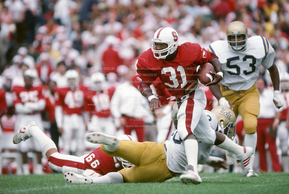 Darrin Nelson #31, Stanford v UCLA, Oct 10, 1981 at Stanford Stadium.  Joe Gary #53 of UCLA gives chase, John Macaulay #66 of Stanford attempts to block a UCLA defender.