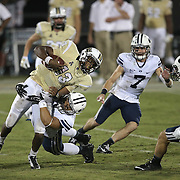 ORLANDO, FL - OCTOBER 09:  Justin Holman #13 of the UCF Knights is tackled by Jherremya Leuta-Douyere #43 of the Brigham Young Cougars at Bright House Networks Stadium on October 9, 2014 in Orlando, Florida. (Photo by Alex Menendez/Getty Images) *** Local Caption ***Justin Holman; Jherremya Leuta-Douyere