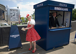 © licensed to London News Pictures. 14/06/2011. Ascot, UK.  Natalie Turner examines a programme on day one at Royal Ascot races today (14/03/2011). The 5 day showcase event, one of the highlights of the racing calendar is in it's 300th year. Horse racing has been held at the famous Berkshire course since 1711 and tradition is a hallmark of the meeting. Top hats and tails remain compulsory in parts of the course. Photo credit should read: Ben Cawthra/LNP