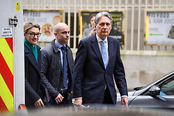 © Licensed to London News Pictures. 21/02/2019. London, UK. Chancellor PHILIP HAMMOND is seen leaving Milbank Studios in Westminster, London following a Radio 4 interview. Conservative and Labour MPs have resigned form their respective parties and joined newly formed The Independent Group, a breakaway campaign group formed by seven defecting Labour MPs. Photo credit: Ben Cawthra/LNP