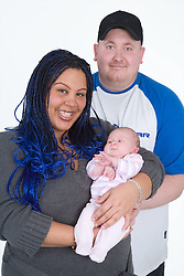 Portrait of a couple with their new born baby,