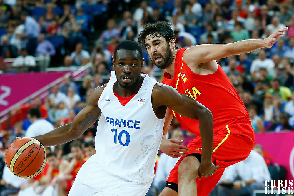 08 August 2012: France Yannock Bokolo drives past Juan-Carlos Navarro during 66-59 Team Spain victory over Team France, during the men's basketball quarter-finals, at the 02 Arena, in London, Great Britain.