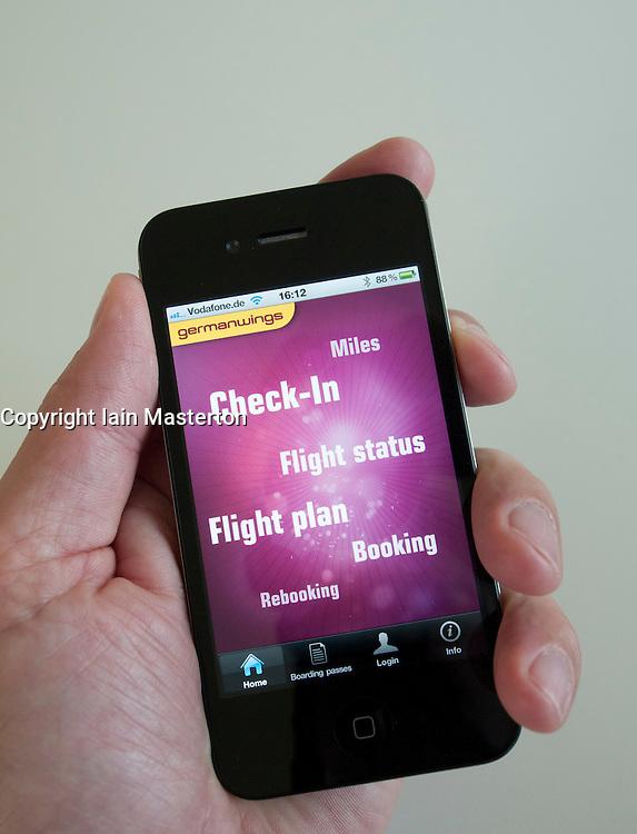 Man using Germanwings app to book flight on an iPhone 4G smart phone