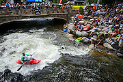 Ben Guska (bottom left), 20, of Glenwood Springs, Co. tries to make it into the top ten of the Sprint Kayak Pro Rodeo Qualifiers on Gore Creek at the Teva Mountain Games in Vail, Co. on Friday June 2, 2006. The top ten move on the semi-finals on Saturday in the event. Guska has been competing in the Teva Mountain Games for four years. The event, which is in its fifth year, features competitions in a number of mountain based sports as well as outdoor gear expos, outdoor film and photography exhibits and events for dogs. The Teva Mountain Games continue through Sunday in Vail..(MARC PISCOTTY/ © 2006)