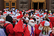 Moscow, Russia, 17/12/2005.&#xA;Putin supporters dressed as Santa Claus walk crowd into the Moscow metro system after a demonstration. Approximately 70,000 members of the pro Kremlin youth organisation Nashi [Ours],  demonstrated to wish World War Two veterans a happy New Year. Most of the demonstrators were dress as Dyed Moroz, the Russian Santa Claus, or his partner Snegurichka, the Snow Maiden.<br />