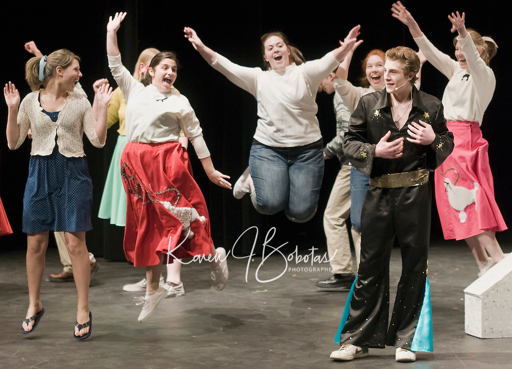 """Rock and Roll star Dustin Condit as """"Conrad Birdie"""" performs on the Ed Sullivan Show much to the delight of the ladies (l-r Amanda Noel """"Margie"""", Nicole Beland """"Nancy"""", Elizabeth Jackman """"Reporter"""", Lily Newton """"Gloria Rasputin and Amy Wargo """"Alice"""" during """"Bye Bye Birdie"""" dress rehearsal Tuesday evening at Interlakes High School.  Bye Bye Birdie will be presented by Interlakes Drama on April 10th-11th and April 17th-18th at 7pm as well as a matinee performance on April 18th at 1pm.  (Karen Bobotas/for the Laconia Daily Sun)"""