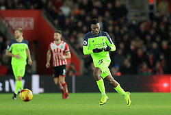 Liverpool's Daniel Sturridge reads instructions on a piece of paper from the dugout during the EFL Cup Semi Final, First Leg match at St Mary's Stadium, Southampton.