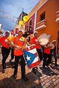 A band parades during the Festival of San Sebastian in San Juan, Puerto Rico.