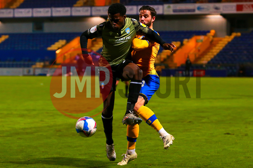 Kwame Poku of Colchester United holds off pressure from Stephen McLaughlin of Mansfield Town - Mandatory by-line: Ryan Crockett/JMP - 20/11/2020 - FOOTBALL - One Call Stadium - Mansfield, England - Mansfield Town v Colchester United - Sky Bet League Two