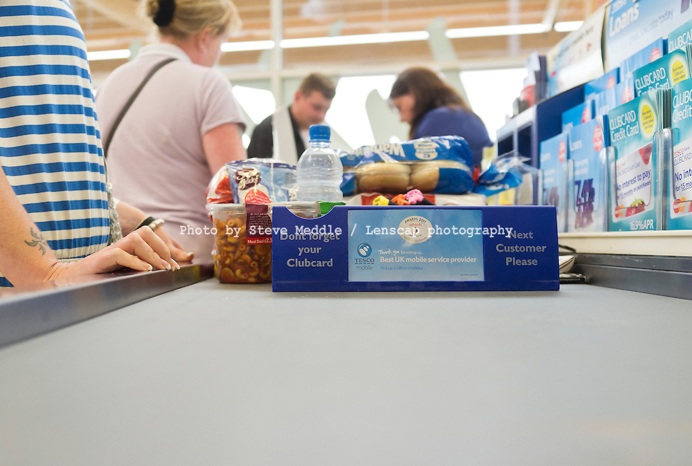 Shopping / Groceries on Conveyor Belt at Checkout in Tesco Supermarket.