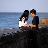 Central America, Cuba, Havana. Couple on the Malecon.