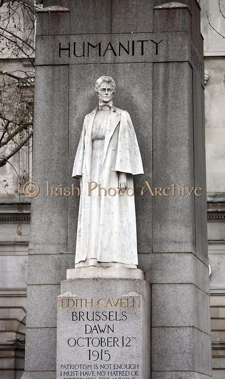 Memorial statue of Edith Cavell, British nurse and patriot. Set at Saint Martin's Place in London, England. Made of White marble against a tall granite cross. Made by Sir George Frampton and unveiled in 1920