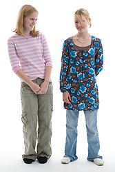 Portrait of two teenage sisters in the studio,