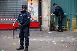 © Licensed to London News Pictures. 16/11/2015. Paris, France. French police setting a new police cordon outside Bataclan Cafe in Paris, France following the Paris terror attacks on Monday, 16 November 2015. Photo credit: Tolga Akmen/LNP