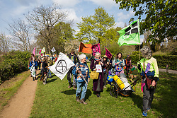 Richmond, UK. 14th April 2019. Climate campaigners from Extinction Rebellion, some of whom had walked from as far away as Land's End, take part in the last leg of the Earth March from Richmond to Hyde Park to join the forthcoming 'International Rebellion UK - Shut Down London!' event to call on the Government to take urgent action to address climate change.