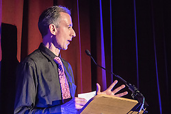 Old Town Hall, Stratford, London - 28 November 2015. Singers Marc Almond, Ronan Parke, Heather Peace and Asifa Lahore headline the Peter Tatchell Foundation's inaugural Equality Ball, a fundraiser for the foundation's LGBTI and human rights work, with guest of honour Sir Ian McKellen  joined by Michael Cashman. PICTURED:  Peter Tatchell addresses the audience.  //// FOR LICENCING CONTACT: paul@pauldaveycreative.co.uk TEL:+44 (0) 7966 016 296 or +44 (0) 20 8969 6875. ©2015 Paul R Davey. All rights reserved.