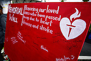 Participants sign a Memorial Wall in honor of loved ones who have passed away due to hear disease and stroke during the 2014 Silicon Valley Heart & Stroke Walk at KLA-Tencor in Milpitas, California, on October 11, 2014. (Stan Olszewski/SOSKIphoto)