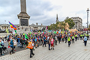 """Protestors dressed as a clown circus march in Trafalgar Square during an Extinction Rebellion protest called """"Corruption Carnival"""" in Westminster, central London on Wednesday, Sept 3, 2020. The environmental campaign group has planned events to be held at several landmarks in the capital. Extinction Rebellion plans to hold 10 days of demonstrations across central London as part of its ongoing campaign to highlight climate change. Environmental nonviolent activists group Extinction Rebellion enters its 3rd day of continuous ten days to disrupt political institutions throughout peaceful actions swarming central London into a standoff, demanding that the central government obeys and delivers Climate and Ecological Emergency Bill and prepare for crisis with a National Citizens' Assembly. (VXP Photo/ Vudi Xhymshiti)"""