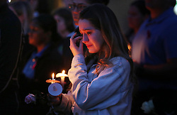 UCF student Aly Justice weeps during a candlelight vigil at Memory Mall on the UCF campus in Orlando, FL, USA, in commemoration of the one-year anniversary of the mass shooting at Marjory Stoneman Douglas High School. The vigil was attended by hundreds on Thursday, February 14, 2019. Photo by Stephen M. Dowell/Orlando Sentinel/TNS/ABACAPRESS.COM