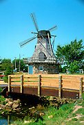 Windmill and small wooden footbridge in the park.   Baldwin Wisconsin USA