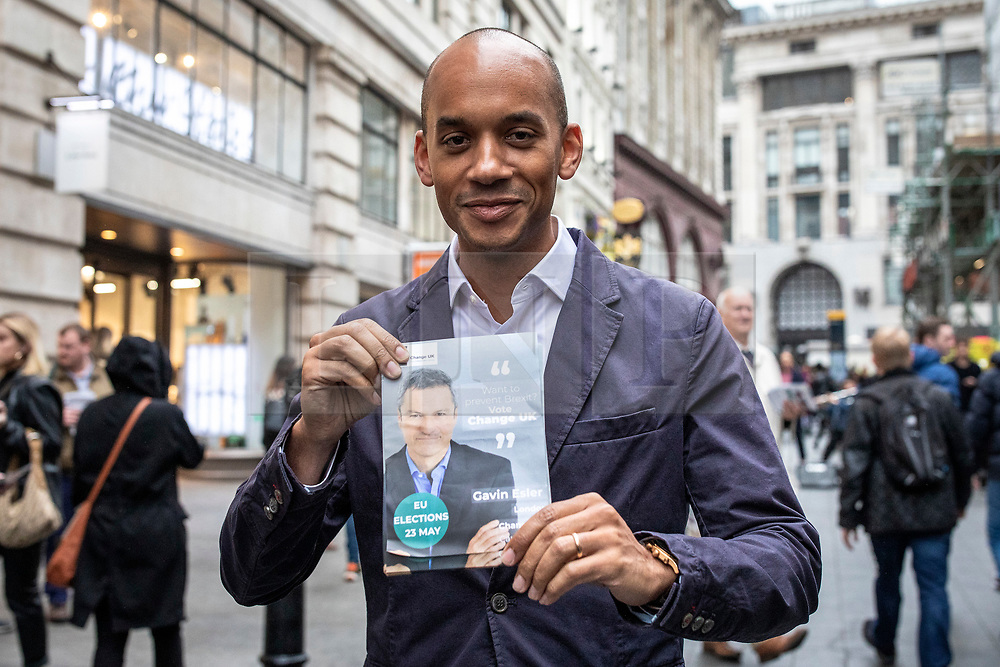© Licensed to London News Pictures. 17/05/2019. London, UK. Change UK MP Chuka Umunna holds up a campaign leaflet while campaigning in central London with MEP candidates Gavin Esler and Martin Bell. Photo credit: Rob Pinney/LNP