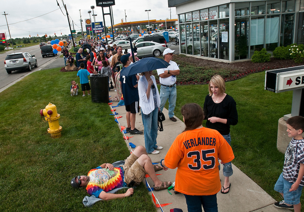 Matt Dixon   The Flint Journal..Hundreds of fans await the arrival of Detroit Tigers pitcher Justin Verlander at Jim Waldron Buick-GMC in Davison Thursday afternoon. The right-hander, who has a record of 4-0 with a 1.08 ERA in June alone, has made appearances at the car dealership since 2006.