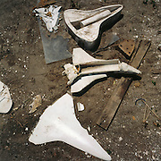 NASA Space Junk Auction.Shuttle model moulds lie in the dirt. They were probably used for displays at NASA PR events.