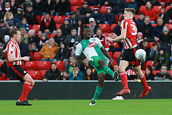 March 2, 2019 - Sunderland, England, United Kingdom - Plymouth Argyle's Freddie Ladapo contests for the ball with Sunderland's Jimmy Dunne and Lee Cattermole during the Sky Bet League 1 match between Sunderland and Plymouth Argyle at the Stadium Of Light, Sunderland on Saturday 2nd March 2019. (Credit Image: © Mi News/NurPhoto via ZUMA Press)