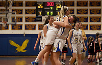 Olivia Trindade gets a hug from team mate Abby O'Connor after their commanding win over Stevens during the opening round of tournament play at Gilford High School Thursday evening.  (Karen Bobotas/for the Laconia Daily Sun)