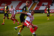 Scott Cuthbert of Stevenage tackles during the EFL Sky Bet League 2 match between Stevenage and Barrow at the Lamex Stadium, Stevenage, England on 27 March 2021.