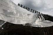Exterior of Grand Central in Birmingham, United Kingdom. Grand Central is a shopping centre located in Birmingham, England, that opened on 24 September 2015. It is currently owned by Hammerson and CPPIB. The original centre was built in 1971 as part of the reconstruction of Birmingham New Street station. It was known as the Birmingham Shopping Centre before being renamed as The Pallasades. As part of the New Street Station Gateway Plus redevelopment, Grand Central underwent a major overhaul. The mall has been redesigned with a glass atrium roof as centrepiece, and is home to over 60 stores with John Lewis as main anchor tenant.