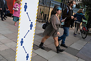 Londoners walk past a new design for social distancing on the capital's streets, on, at the Piccadilly entrance to Green Park, and during the second (Autumn) spike during the Coronavirus pandemic, on 5th October 2020, in London, England.