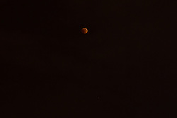 The full Moon turns red during total lunar eclipse with planet Mars under the Moon in Krasnodar, Russia on July 27, 2018. Photo by Nasser Berzane/ABACAPRESS.COM.