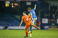 Luton Town defender Matthew Pearson (6) and Bradford City forward Eoin Doyle (9) battle over the ball during the EFL Sky Bet League 1 match between Luton Town and Bradford City at Kenilworth Road, Luton, England on 27 November 2018.