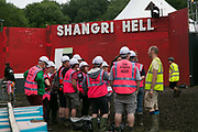 A team of fire stewards are briefed at Shangri-la ahead of the start of Glastonbury Festival 19th July 2016, Somerset, United Kingdom. Shangri-la is a venue at the festival with  art and politics mixed with tunes and all night club nights. Work getting the festival ready takes weeks and in the days up to the festival starts work is frantic.  The Glastonbury Festival runs over 3 days and has 3000 acts, including music, art and performance and approx. 150.000 attend the anual event.