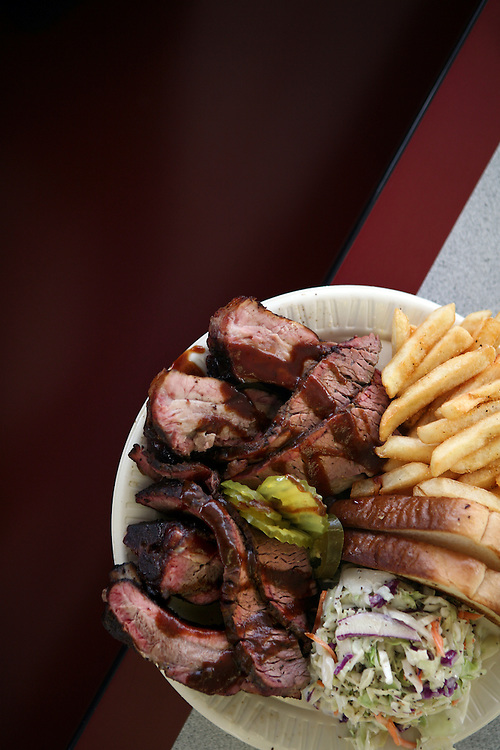 Sliced beef and ribs with cole slaw, french fries and Texas toast at Off the Bone BBQ in Forest Hill, TX.