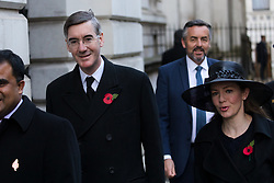 © Licensed to London News Pictures. 10/11/2019. London, UK. Leader of the House of Commons, Jacob Rees-Mogg and his wife Helena de Chair walk through Downing Street to attend the Remembrance Sunday Ceremony at the Cenotaph in Whitehall. Remembrance Sunday events are held across the country today as the UK remembers and honours those who have sacrificed themselves in two world wars and other conflicts. Photo credit: Vickie Flores/LNP