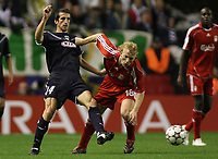 Photo: Paul Thomas.<br /> Liverpool v Bordeaux. UEFA Champions League, Group C. 31/10/2006.<br /> <br /> Dirk Kuyt (R) of Liverpool gets away from Johan Micoud.