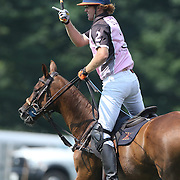 Kris Kampsen, K.I.G. celebrates after scoring during the White Birch Vs K.I.G Polo match in the Butler Handicap Tournament match at the Greenwich Polo Club. White Birch won the game 11-8. Greenwich Polo Club,  Greenwich, Connecticut, USA. 12th July 2015. Photo Tim Clayton