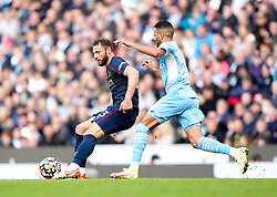 Burnley's Erik Pieters (left) and Manchester City's Riyad Mahrez battle for the ball during the Premier League match at the Etihad Stadium, Manchester. Picture date: Saturday October 16, 2021.