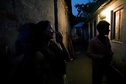 Sex worker Shetu, 17, looks for a customer at brothel in Tangail, Bangladesh.