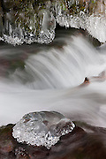 """Wahkeena Creek flows by crystal-like icy formations after a week of subfreezing temperatures on the Oregon side of the Columbia River Gorge. Wahkeena is a phase from the Yakima Native American tribe, which means """"most beautiful."""""""