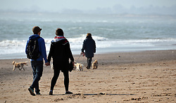 © Licensed to London News Pictures. 08/03/2014. Exmouth, UK. People enjoying the warm weather  on Exmouth beach, in Dorset. With Temperatures expected to hit 18 degrees over the weekend, Areas in the south ofEngland are set for the warmest temperatures this year. Photo credit : Russ Nolan/LNP
