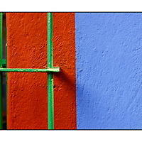 Orange wall and blue paint with green window bars;<br />